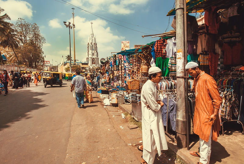 Download Two Muslim Men Meeting And Talking On Market Street With Clothing Strores Editorial Stock Photo - Image of pakistan, businessman: 92165703