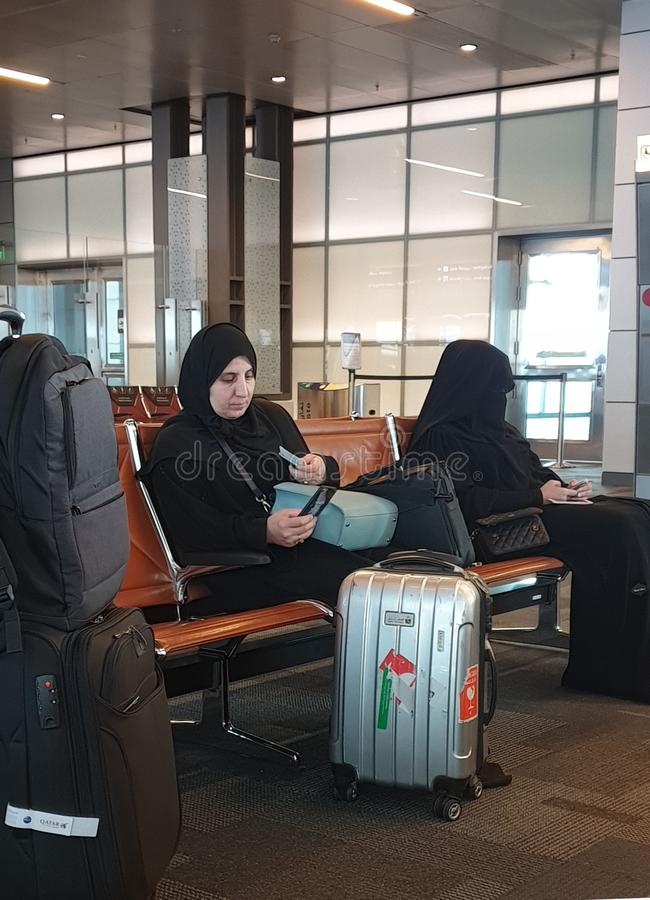 Two muslim women at the airport stock images