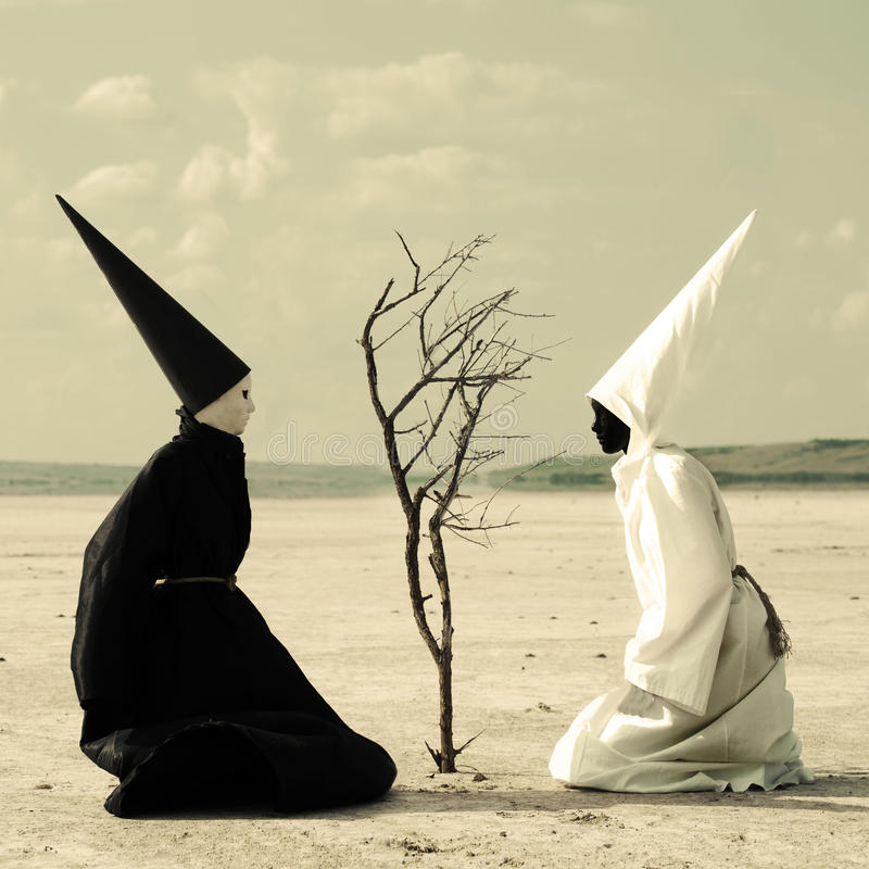 Two mysterious persons and a dry tree stock photography