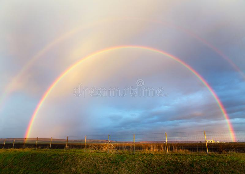 Two natural rainbow stock image