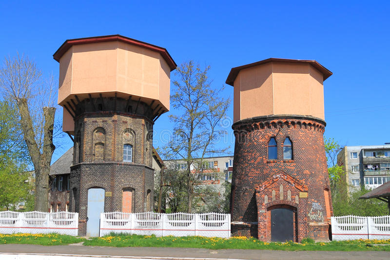 Two nearby the standing railway water towers of Gumbinnen stock images