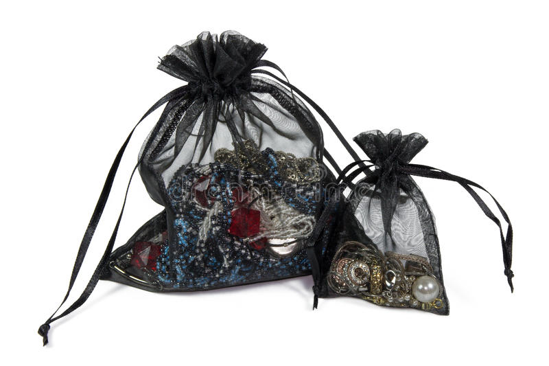 Two net pouches with jewelry stock photo