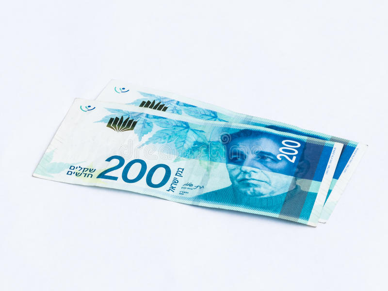 Two new banknotes worth 200 Israeli new shekels on a white background royalty free stock images
