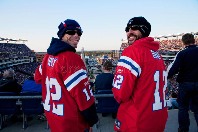Two New England Patriots fans. Two New England Patriots NFL Football fans at Gillette Stadium, the home of Super Bowl champs. New England Patriots vs. the Dallas royalty free stock image