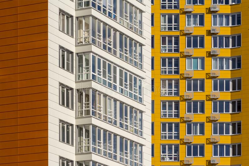 Two new high-rise residential buildings. White and yellow houses in new area royalty free stock photo