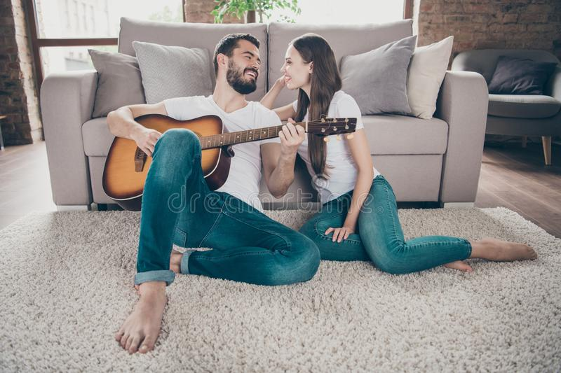 Two nice attractive lovely tender cheerful cheery positive people having fun spending day holiday weekend sitting on stock images