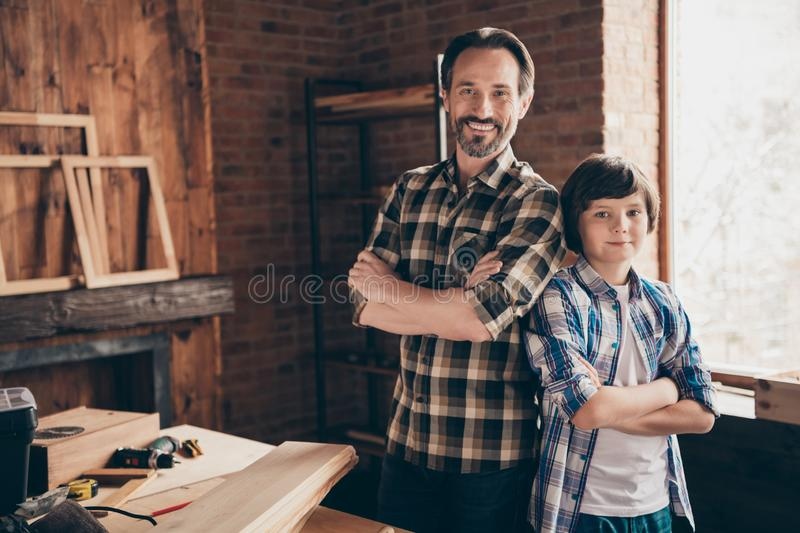 Two nice person cheerful cheery content ready artisan woodworkers handymen folded arms at school course class studio. Two nice person cheerful cheery content stock photos