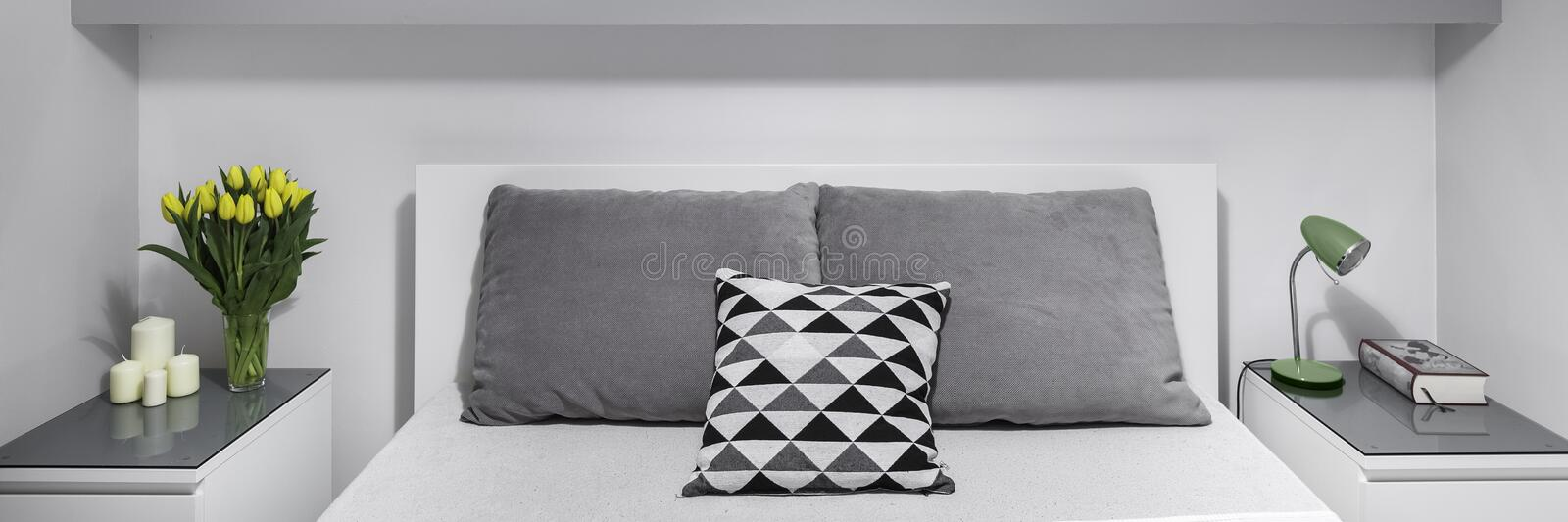 Two nightstands next to bed stock photography