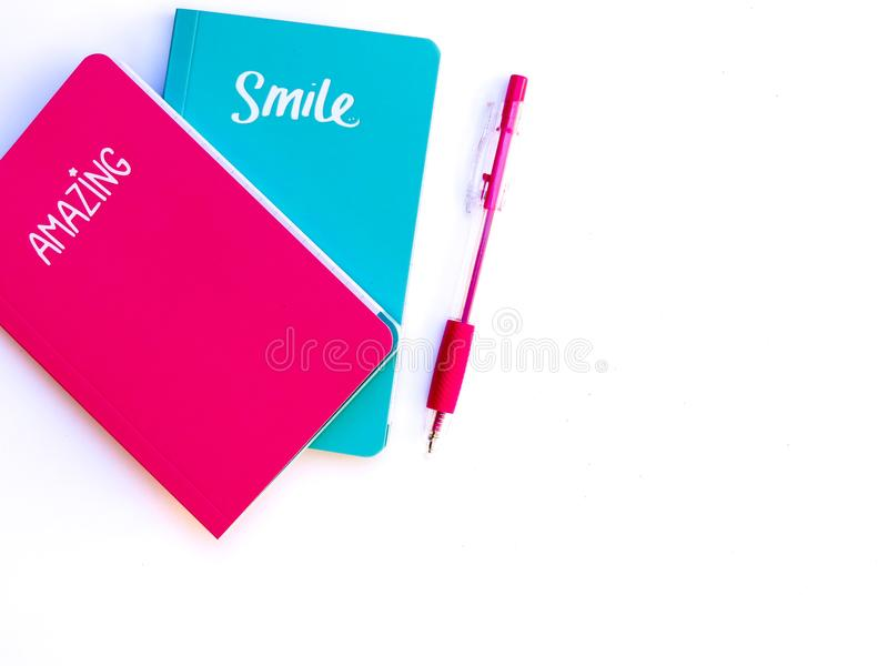 Two note books marked Amazing and Smile