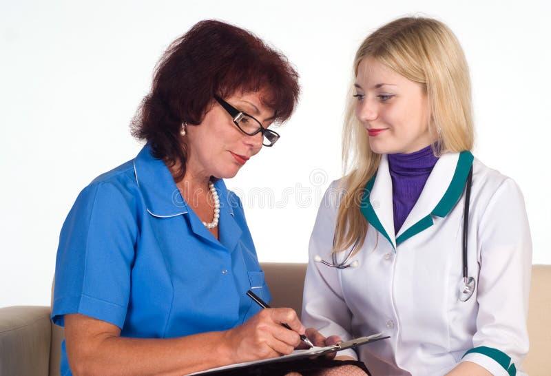 Two nurses sit stock photography