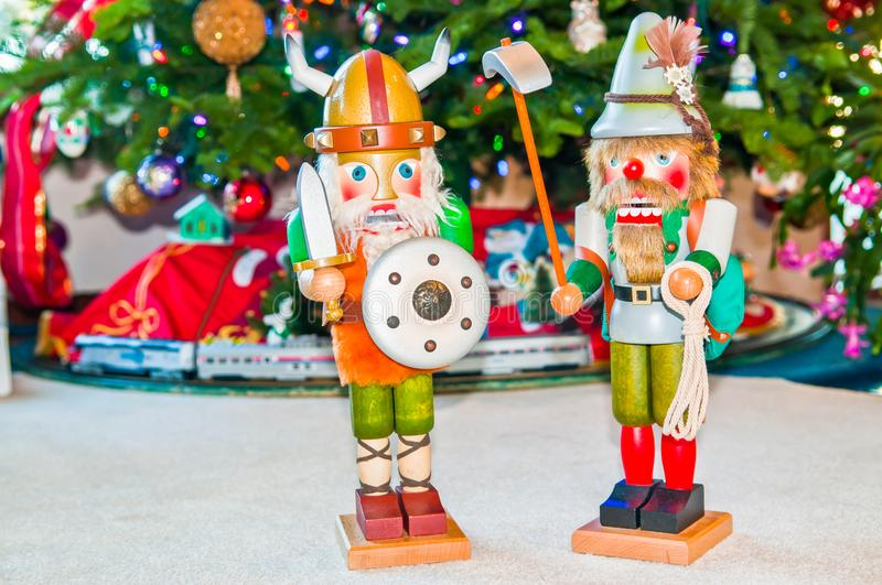 Two Nutcrackers at Base of Christmas Tree stock photography
