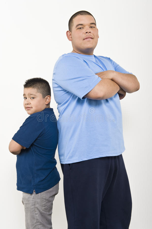 Two Obese Brothers Standing Back To Back Stock Photo