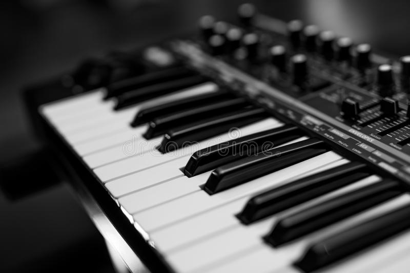 Two octaves electronic musical keyboard synthesizer close-up. royalty free stock photos