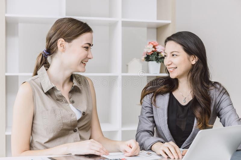 Two office business girl looking together smiling stock images