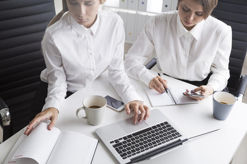 Two office employees at one table royalty free stock images