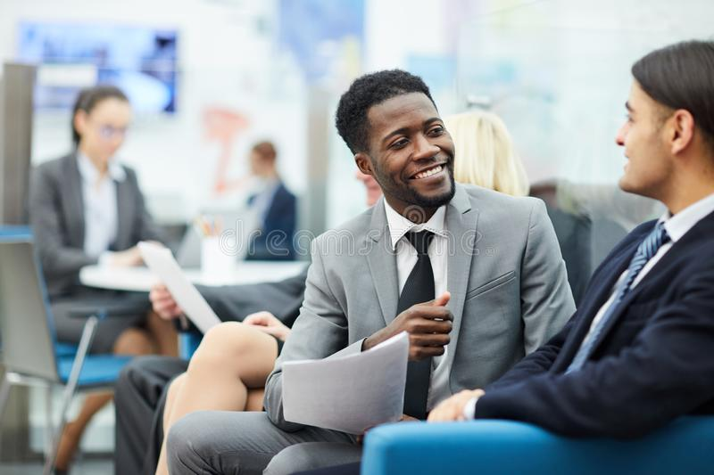 Two Office Workers Talking stock photos