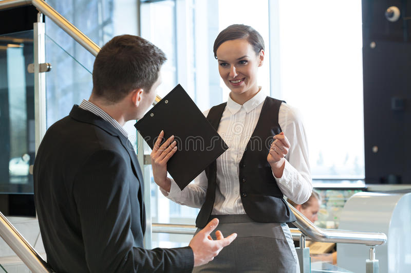 Two office workers talking royalty free stock photo