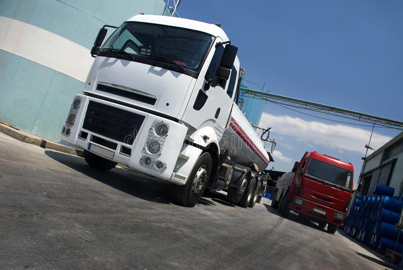 Two oil truck. Front of the big fuel silo royalty free stock images