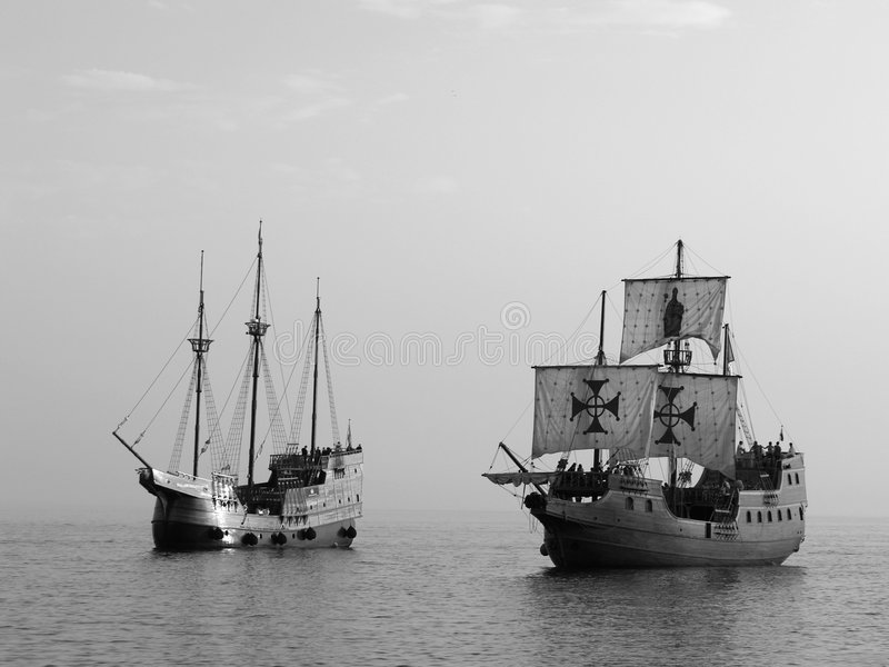 Two Old battle ships at sea stock photos