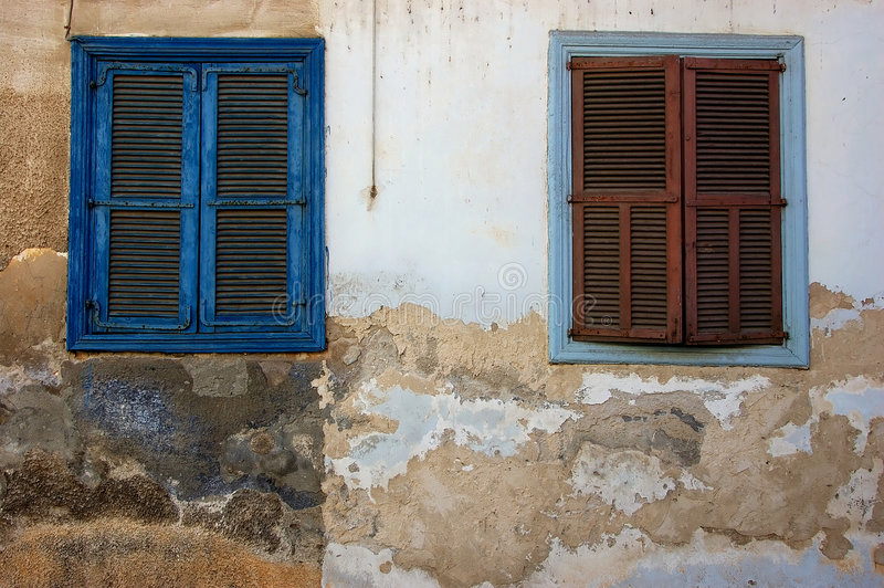 Two old blue windows. In Neve Tzedek in Tel-Aviv stock photos