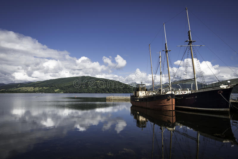 Two old boats in a lake royalty free stock image
