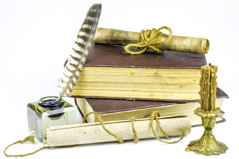 Two old books of brown color, documents in scrolls, inkwell with feather, candle isolated on a white background. Two old books of brown color, documents in royalty free stock images