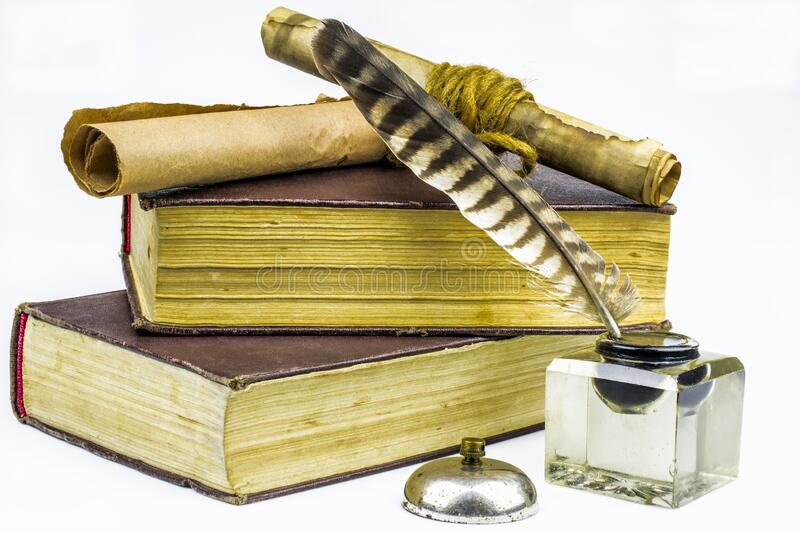 Two old books of brown color, documents in scrolls, inkwell with feather  isolated on a white background. Two old books of brown color, documents in scrolls, a stock photo