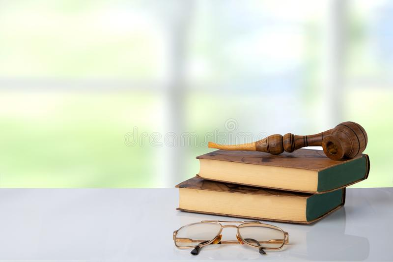Two old books with a tobacco pipe on them and a pair of glasses in front of bright background. The teachers day. Back to school. S. Pace stock photo