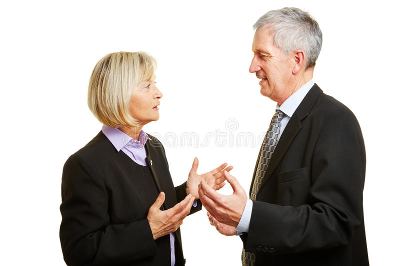 Two old businesspeople talking. And argueing in a discussion royalty free stock images