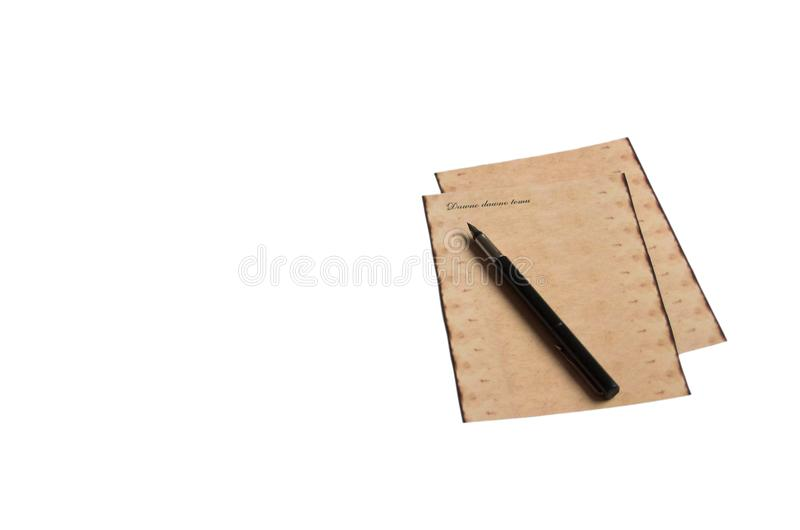 Old cards with an inscription and an elegant fountain pen on a. Two old cards with an inscription and an elegant fountain pen on a white isolated background stock photo