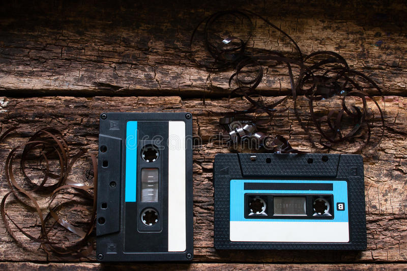 Two old Cassette tape on a wooden. Background stock image