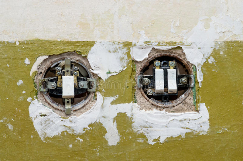 Two old electric switches mounted in the wall. The covers of switches is open stock photo