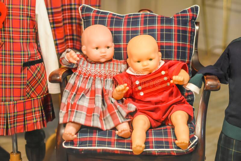 Old Fashioned Baby Dolls in Chair royalty free stock photography