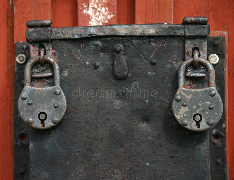Two old iron padlocks stock photos