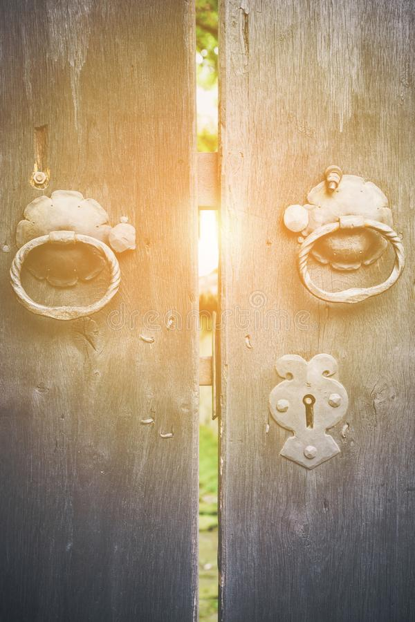 Free Two Old Iron Ring Handles On A Door Standing Ajar Royalty Free Stock Photos - 104384538