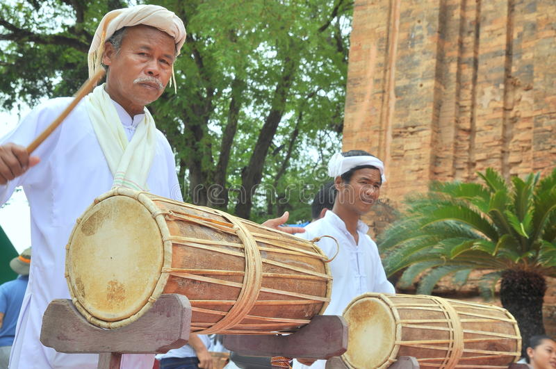 Two old men are performing the traditional drums technique of champa at the Po Nagar temple in Nha Trang royalty free stock photo