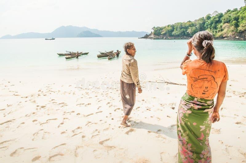 Two old Moken woman on white sand beach. Sea gypsy, Moken live a. Tanintharyi, Myanmar – JANUARY 24, 2018: Two old Moken woman on white sand beach. Sea royalty free stock photography
