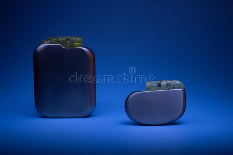 Two old pacemaker collection on a neutral background. High technology medicine. Two old pacemaker collection on a neutral background. Implantable devices in royalty free stock images