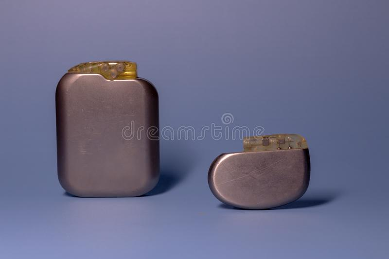 Two old pacemaker collection on a neutral background. Implantable devices in humans. High technology medicine royalty free stock photos