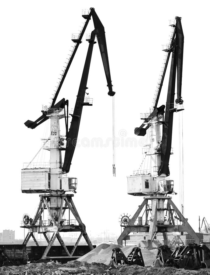 Two old port crane isolated on white background. Construction site stock photos