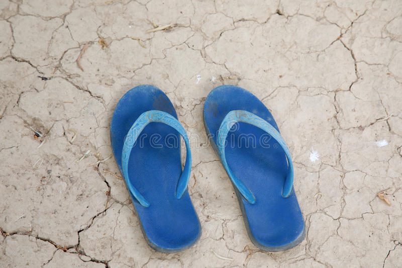 Two old sandals. Two old sandals to lay down on arid ground stock photography