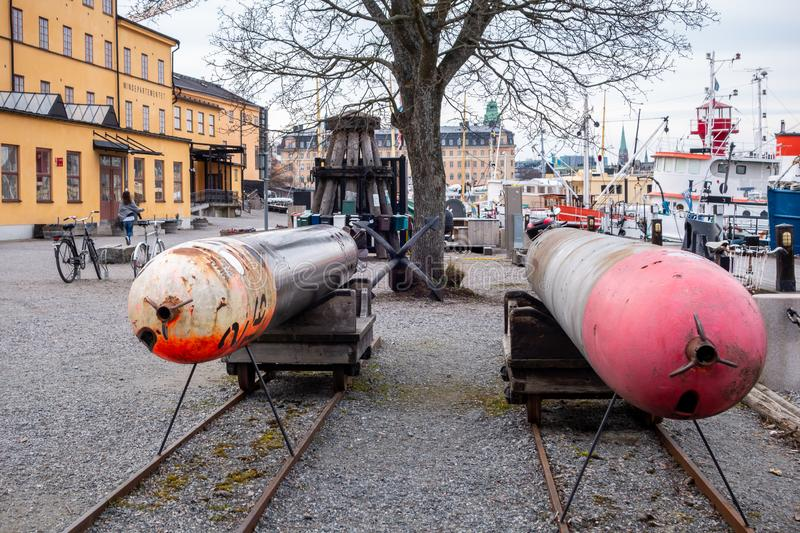 Two old submarine torpedoes outside the museum Torpedverkstaden in Stockholm Sweden. STOCKHOLM, SWEDEN - APRIL 6, 2015: Front view of two old submarine stock photo