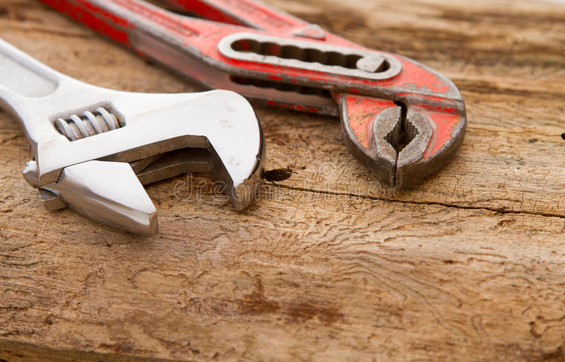 Two old vintage plumbers pipe wrench royalty free stock images