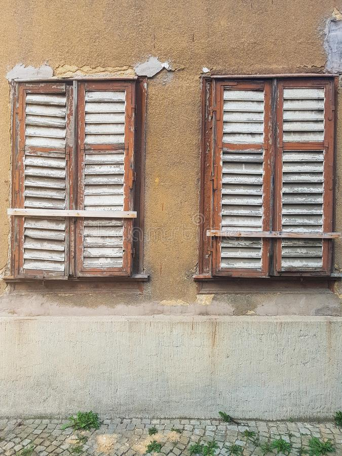 Two old windows. Brown, geometry royalty free stock images