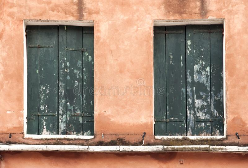 Two old windows in Venice. stock photos