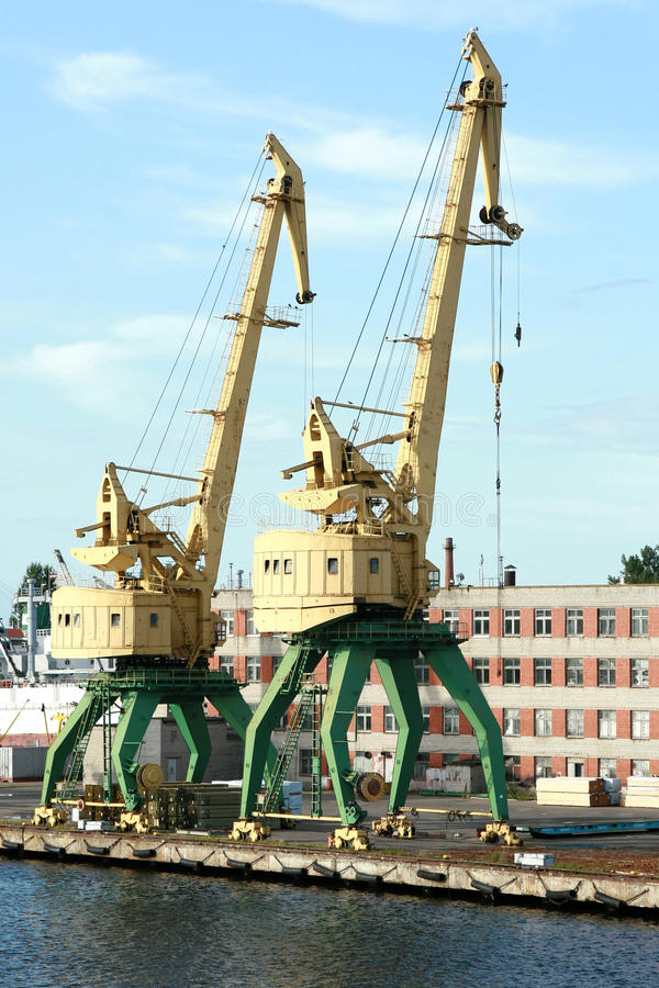 Download Two Old Yellow Harbor Crane Stock Photo - Image of bulk, modern: 10930904
