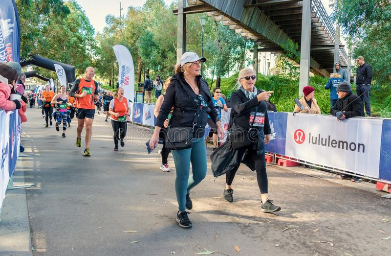 Two older ladies during Run Melbourne. Two relaxed and cool older ladies are walking during Run Melbourne on 29/07/2018. Run Melbourne is running event in royalty free stock photo