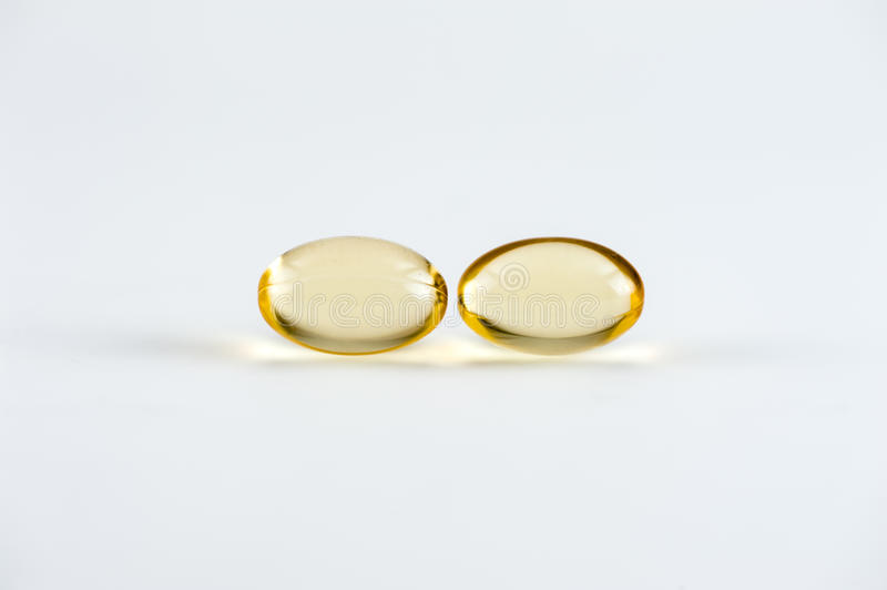 Download Two Omega-3 Capsules Royalty Free Stock Photo - Image: 26240475
