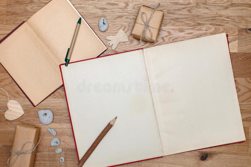 Two open books on the table. View from the top. Parcels or gifts associated with twine. The vintage style. stock photo