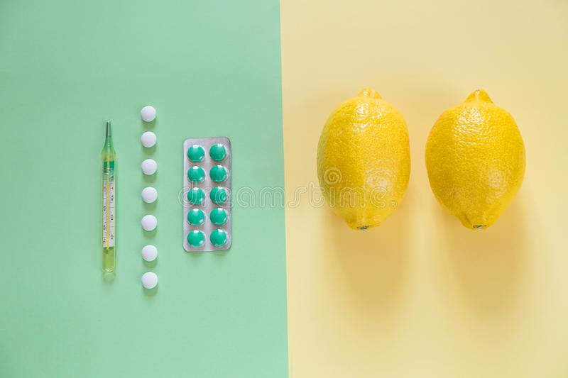 Two opposite medication. Home and science medication. Some medication on two-color paper background. Top view of wo opposite medication. Home and science royalty free stock photo